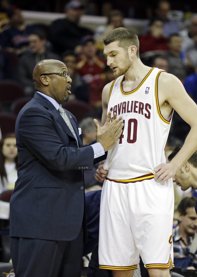 Photo - In this April 9, 2014 photo, Cleveland Cavaliers head coach Mike Brown talks to Tyler Zeller during an NBA basketball game against the Detroit Pistons in Cleveland. On Monday, May 12, 2014, the Cavaliers announced Brown has been released as head coach. (AP Photo)