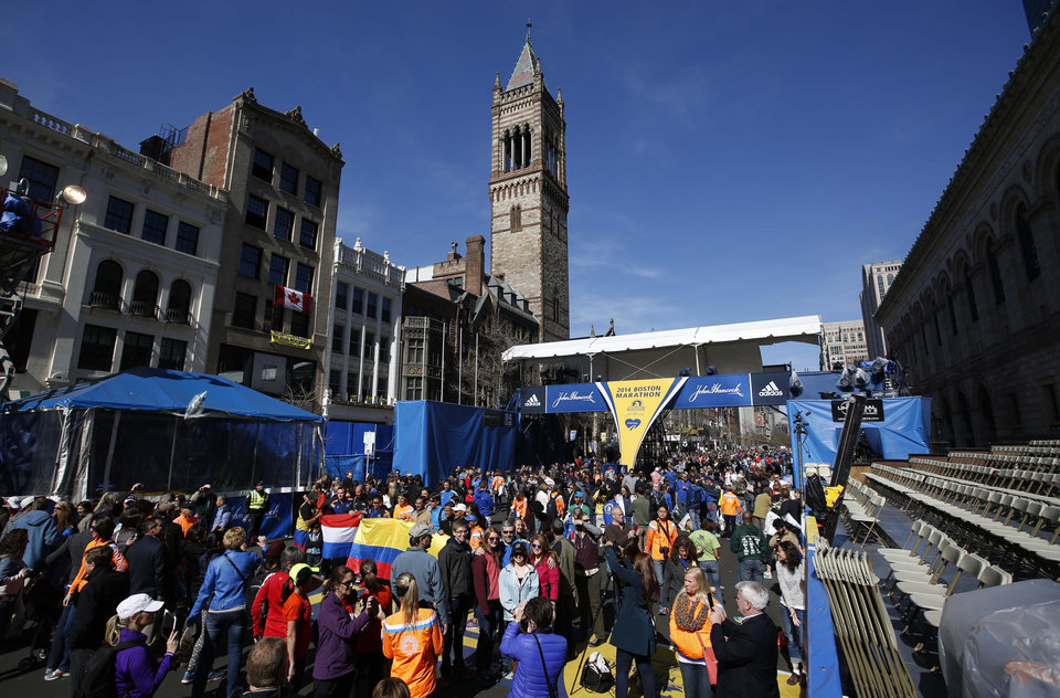 Photo - Runners and race fans crowd Boyslton Street at the Boston Marathon finish line, one day before the race, Sunday, April 20, 2014, in Boston.  (AP Photo/Robert F. Bukaty)