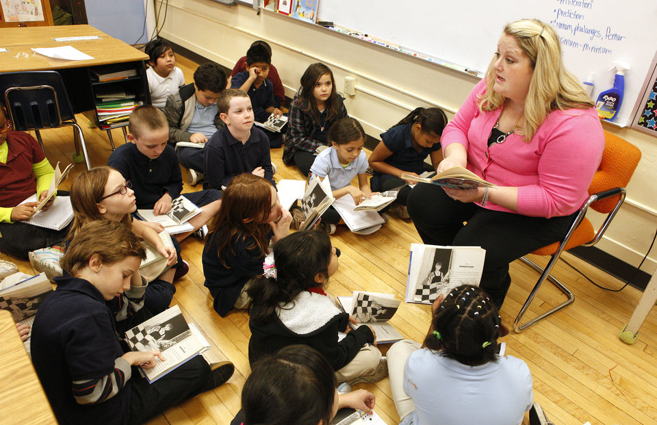 "Teacher Kristin Whitmore works on a reading assignment with her third-graders from the book ""Stone Fox"" at Sequoyah Elementary in northwest Oklahoma City. <strong>PAUL B. SOUTHERLAND - THE OKLAHOMAN</strong>"