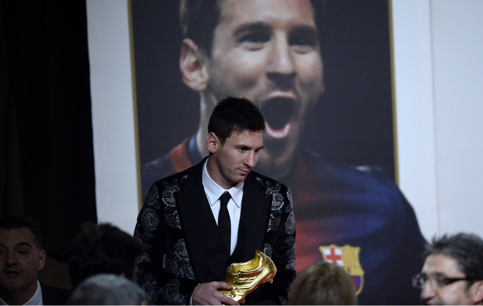 Photo - Barcelona's Lionel Messi from Argentina poses for the media after receiving his Golden Boot award for scoring the most goals in Europe's domestic leagues last season in Barcelona, Spain, Wednesday, Nov. 20, 2013. (AP Photo/Manu Fernandez)