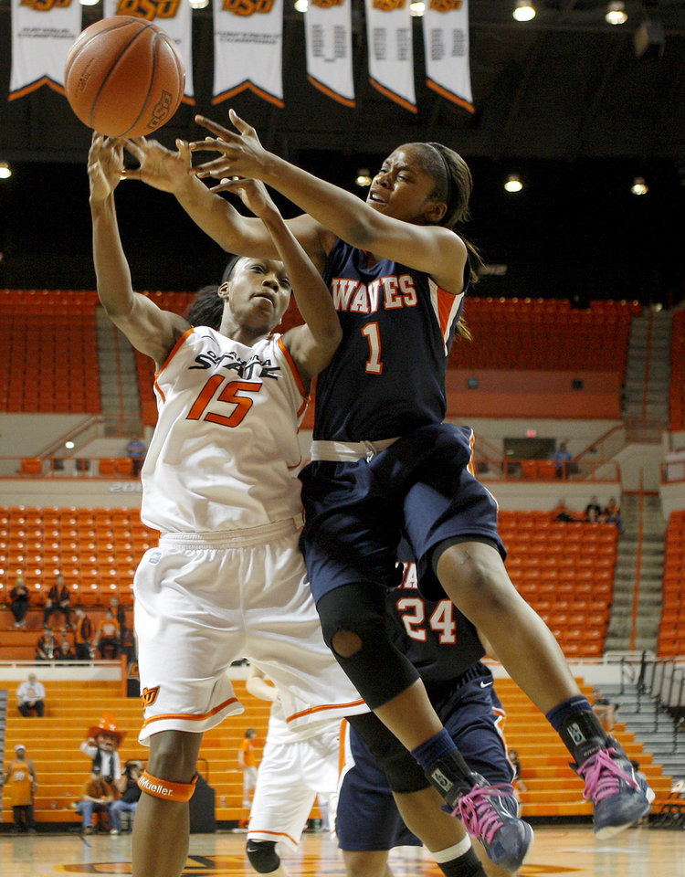 OSU\'s Toni Young (15) and Pepperdine\'s Robie Mayberry (1) go for the ball during a first-round NIT women\'s college basketball game between Oklahoma State University (OSU) and Pepperdine at Gallagher-Iba Arena in Stillwater, Okla., Wednesday, March 16, 2011. Photo by Bryan Terry, The Oklahoman