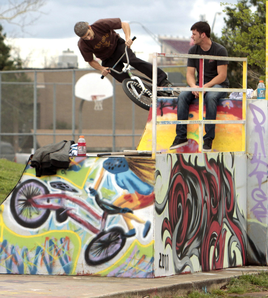 Max Kersey (on bike) and Jonathan Roberson ride at Blake Baldwin Skate Park on Tuesday, March 20, 2012, in Norman, Okla.   Photo by Steve Sisney, The Oklahoman