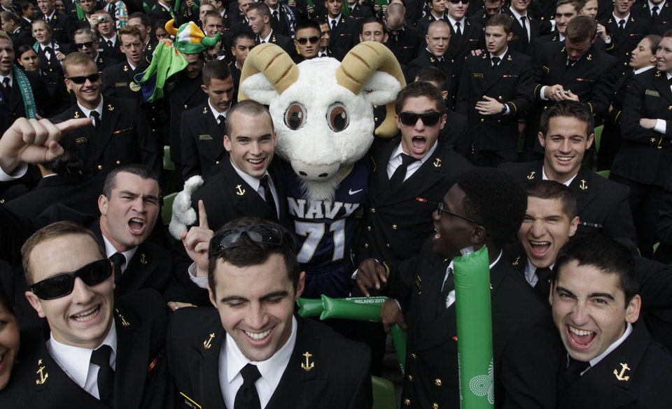 Photo -   Members of the Navy with their mascot as they watch their side play Notre Dame in the NCAA college football game in Dublin, Ireland, Saturday, Sept. 1, 2012. (AP Photo/Peter Morrison)