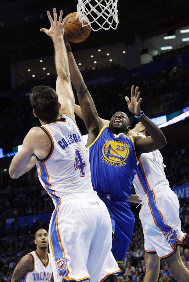 Golden State Warriors forward Draymond Green (23) shoots between Oklahoma City Thunder forward Nick Collison (4) and guard Kevin Martin (23) in the first quarter of an NBA basketball game in Oklahoma City, Sunday, Nov. 18, 2012. (AP Photo/Sue Ogrocki)