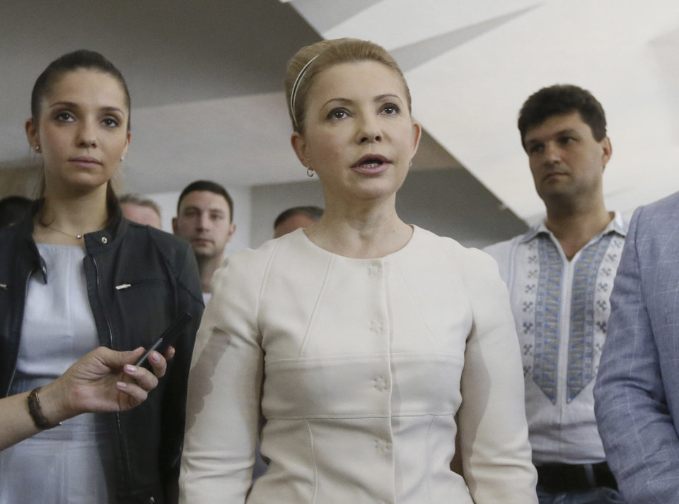 Photo - Ukraine's presidential candidate Yulia Tymoshenko speaks to press at a polling station during the presidential election in Dnipropetrovsk, Ukraine, Sunday, May 25, 2014. Ukraine's critical presidential election got underway Sunday under the wary scrutiny of a world eager for stability in a country rocked by a deadly uprising in the east. (AP Photo/Olexander Prokopenko, pool)