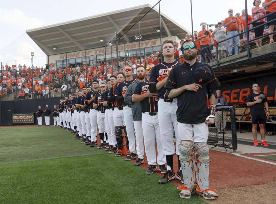 Photo - The OSU Cowboys stand for the national anthem before a college baseball game between Baylor and Oklahoma State in the last regular-season series at Allie P. Reynolds Stadium in Stillwater, Okla., Friday, May 17, 2019. [Nate Billings/The Oklahoman]