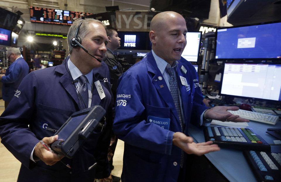 Photo - Trader Timothy Nick, left, and specialist Mario Picone work on the floor of the New York Stock Exchange Tuesday, Aug. 19, 2014. Better news on home building and corporate earnings are sending stocks higher. (AP Photo/Richard Drew)
