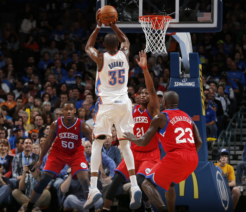 Oklahoma City\'s Kevin Durant (35) shoots a three-point basket in front of Philadelphia\'s Lavoy Allen (50), Thaddeus Young (21) and Jason Richardson (23) during the NBA game between the Oklahoma City Thunder and the Philadelphia 76ers at the Chesapeake Energy Arena in Oklahoma City, Friday,Jan. 4, 2013. Photo by Sarah Phipps, The Oklahoman