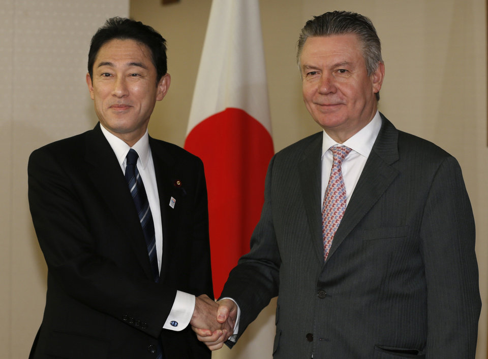 Photo - European Trade Commissioner Karel De Gucht, right, and Japanese Foreign Minister Fumio Kishida pose for photographers prior to their meeting at the Foreign Ministry in Tokyo, Monday, March 25, 2013. De Gucht is in Tokyo and meeting with Japanese government and business officials as scheduled. (AP Photo/Shizuo Kambayashi)