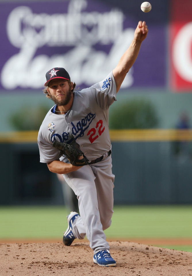 Photo - Los Angeles Dodgers starting pitcher Clayton Kershaw works against the Colorado Rockies in the first inning of a baseball game in Denver, Friday, July 4, 2014. (AP Photo/David Zalubowski)