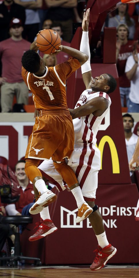 Photo - Oklahoma Sooner Buddy Hield (24) tries to block a shot by Texas Longhorn's Isaiah Taylor (1) in the second half as the University of Oklahoma Sooners (OU) men defeat the Texas Longhorns (TU) 77-65 in NCAA, college basketball at The Lloyd Noble Center on Saturday, March 1, 2014  in Norman, Okla. Photo by Steve Sisney, The Oklahoman