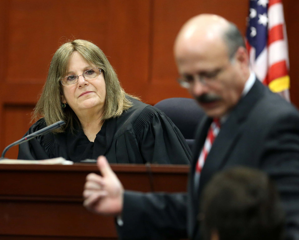 Photo - Judge Debra Nelson, left, and Assistant State Attorney Bernie de la Rionda listen to a read-back of testimony from a prospective juror during the George Zimmerman trial in Seminole circuit court, in Sanford, Fla., Wednesday, June 12, 2013. Zimmerman has been charged with second-degree murder for the 2012 shooting death of Trayvon Martin.(AP Photo/Orlando Sentinel, Joe Burbank, Pool)