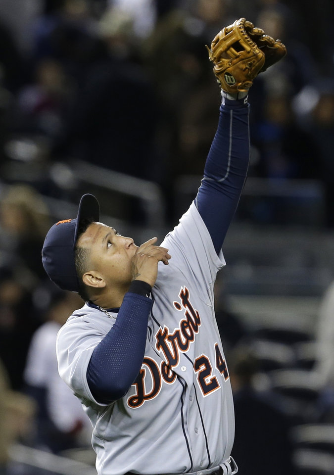 Detroit Tigers third baseman Miguel Cabrera celebrates after the Tigers beat the New York Yankees 6-4 in Game 1 of the American League championship series early Sunday, Oct. 14, 2012, in New York. (AP Photo/Paul Sancya )