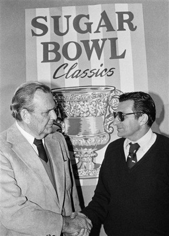 "Opposing Sugar Bowl coaches Paul ""Bear"" Bryant of Alabama (left) shares a smile with Penn State's Joe Paterno as they met for a press conference in New Orleans, on Thursday night, Dec. 28, 1978.    The two teams do battle in a game January 1, 1979 that could decide the national championship. (AP Photo)"