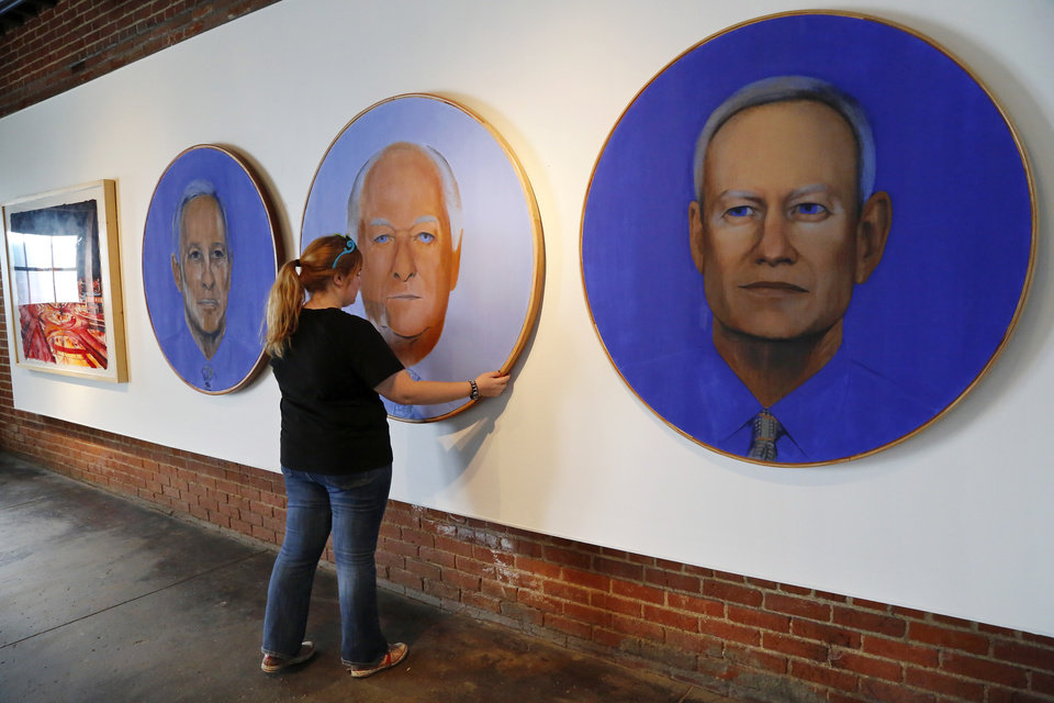 Photo -      Kendall Brown, executive director, Individual Artists of Oklahoma, with paintings of three Oklahoma City mayors painted by Richard McKown. An exhibit at the IAO Gallery will honor the 20th anniversary of MAPS. Photo by Jim Beckel, The Oklahoman   Jim Beckel -