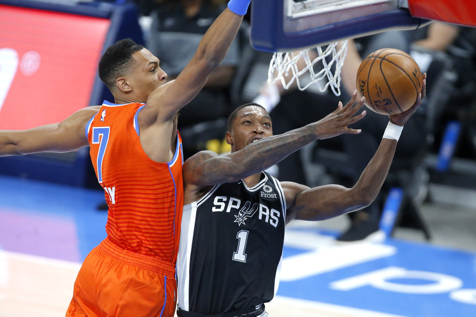 Photo - San Antonio's Lonnie Walker IV goes to the basket past Oklahoma City's Darius Bazley (7) during an NBA basketball game between the Oklahoma City Thunder and the San Antonio Spurs at Chesapeake Energy Arena in Oklahoma City, Tuesday, Jan. 12, 2021. [Bryan Terry/The Oklahoman]
