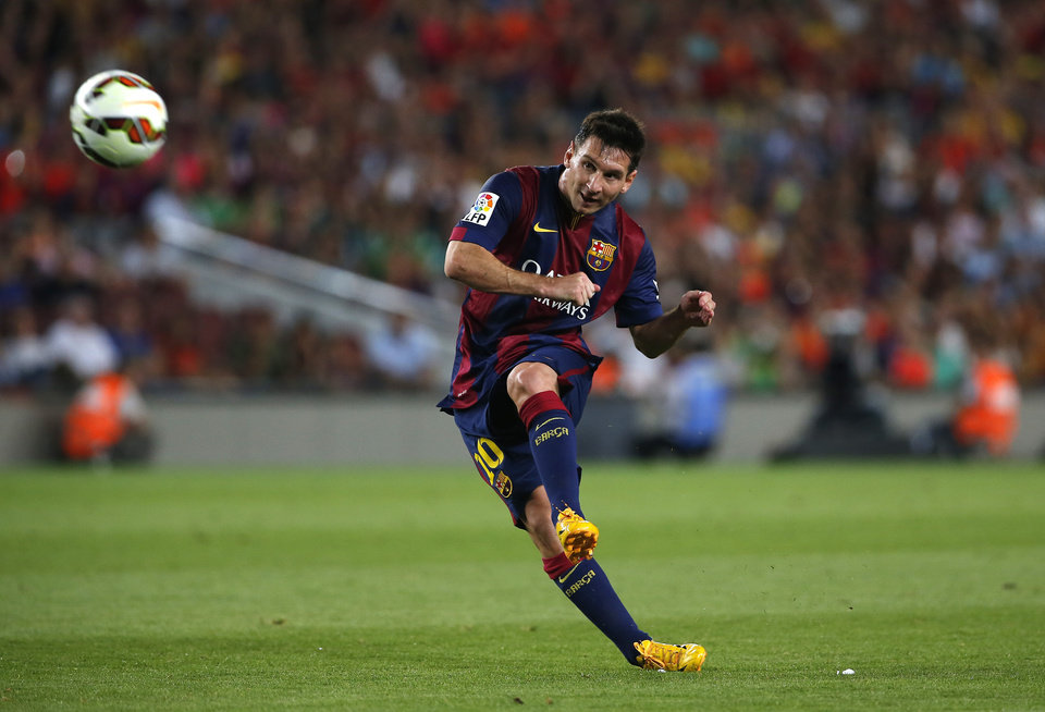 Photo - Barcelona's Lionel Messi from Argentina kicks the ball during the Joan Gamper trophy friendly soccer match between Barcelona and Leon at the Camp Nou stadium in Barcelona, Spain, Monday, Aug. 18, 2014. (AP Photo/Emilio Morenatti)