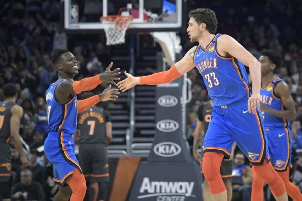 Photo -  Oklahoma City Thunder guard Dennis Schroder (17) and forward Mike Muscala (33) celebrate after scoring a basket during the second half of an NBA basketball game against the Orlando Magic Wednesday, Jan. 22, 2020, in Orlando, Fla. (AP Photo/Phelan M. Ebenhack)