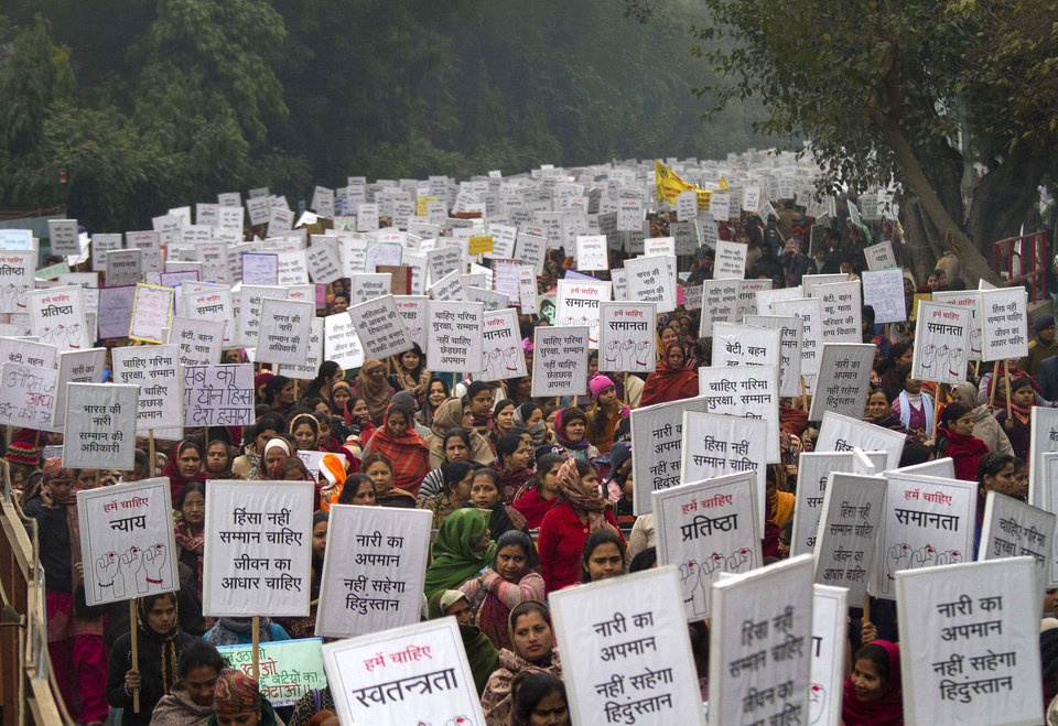 "Indian women carry placards as they march to mourn the death of a gang rape victim in New Delhi, India, Wednesday, Jan. 2, 2013. India's top court says it will decide whether to suspend lawmakers facing sexual assault charges as thousands of women gathered at the memorial to independence leader Mohandas K. Gandhi to demand stronger protection for their safety. The banners read ""India won't tolerate women's insult and We want respect not violence in life."" (AP Photo/ Dar Yasin)"