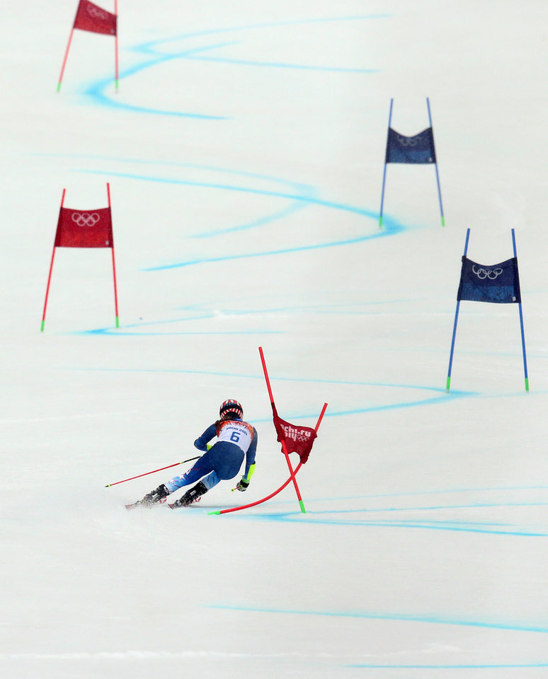 Photo - United States' Mikaela Shiffrin passes a gate in the second run of the women's giant slalom at the Sochi 2014 Winter Olympics, Tuesday, Feb. 18, 2014, in Krasnaya Polyana, Russia. (AP Photo/Alessandro Trovati)