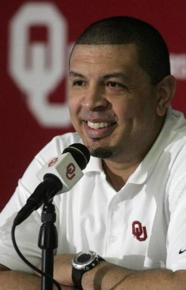 University of Oklahoma men\'s head basketball coach Jeff Capel smiles during a news conference in Norman, Okla., Friday, April 16, 2010. (AP Photo/Sue Ogrocki)