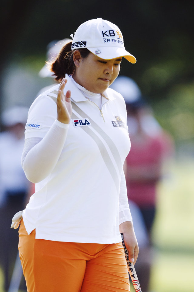 Photo - Inbee Park, of South Korea, acknowledges the crowd on the fourth green during the second round of the Marathon Classic golf tournament at Highland Meadows Golf Club in Sylvania, Ohio, Friday, July 19, 2013. (AP Photo/Rick Osentoski)