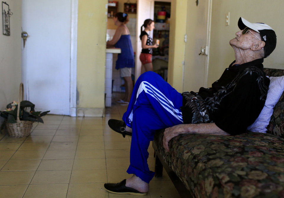 Photo - In this April 23, 2013 photo, Conrado Marrero, the world's oldest living former major league baseball player, sits in his home two days before is 102nd birthday, in Havana, Cuba.  In addition to his longevity, the former Washington Senator has much to celebrate this year. After a long wait, he finally received a $20,000 payout from Major League baseball granted to old-timers who played between 1947 and 1979. The money had been held up since 2011 due to issues surrounding the 51-year-old U.S. embargo on Cuba, which prohibits most bank transfers to the Communist-run island. But the payout finally arrived in two parts, one at the end of last year, and the second a few months ago, according to Marrero's family. (AP Photo/Franklin Reyes)