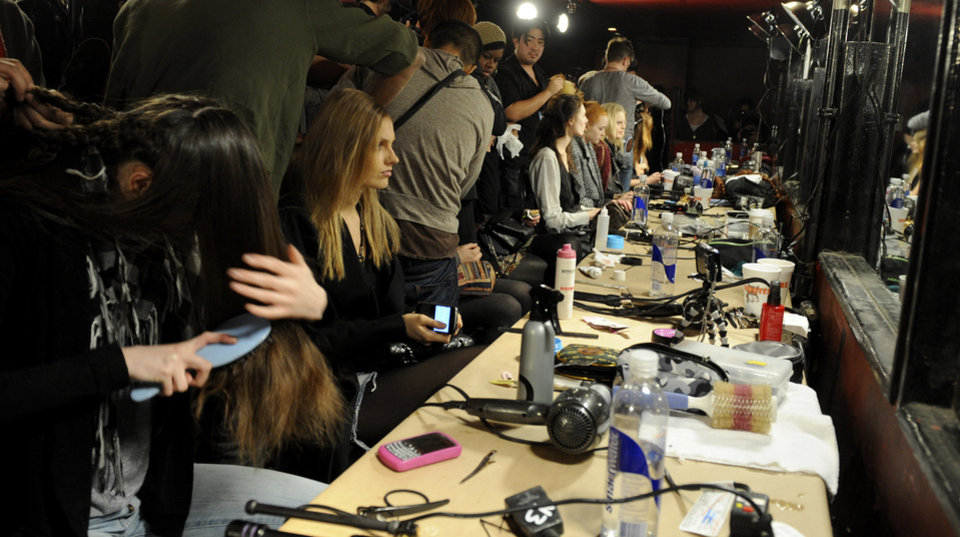 Hair stylists prepare models backstage before the showing of the fall 2009 collection of Alexander Wang during Fashion Week, Saturday, Feb. 14, 2009, in New York. (AP Photo/ Louis Lanzano)