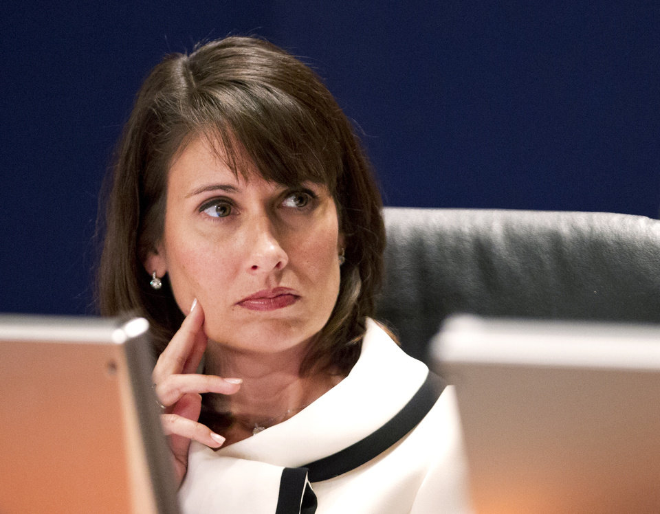 Photo -   National Transportation Safety Board (NTSB) Chair Deborah Hersman listens to testimony in Washington Tuesday, July 10, 2012, during a NTSB meeting to determine a cause of a pipeline rupture in 2010 that dumped more than 800,000 gallons of oil into a southwestern Michigan river. (AP Photo/Manuel Balce Ceneta)