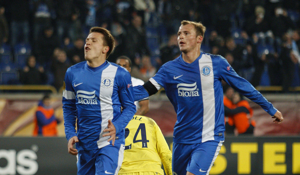 Photo - FC Dnipro's Yevhen Konoplyanka, left, and Roman Zozulya celebrate after socring a goal against Tottenham  during their UEFA Europa League round of 32, first leg soccer match at GSP Stadium in Dnipropetrovsk, Ukraine,Thursday, Feb.20, 2014. (AP Photo/Sergei Kozin)