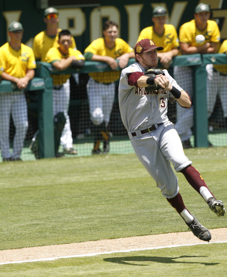 Photo - Arizona State third baseman Dalton Dinatale throws a runner out at first base during the first inning of an NCAA college baseball tournament regional game against Sacramento State on Saturday, May 31, 2014, in San Luis Obispo, Calif. (AP Photo/Aaron Lambert)