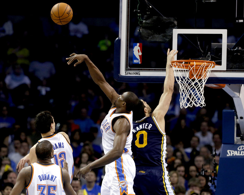 Photo - Oklahoma City 's Serge Ibaka (9) blocks the shot of Utah's Enes Kanter (0) during the NBA game between the Oklahoma City Thunder and the Utah Jazz at the Chesapeake Energy Arena, Sunday, March 30, 2014, in Oklahoma City. Photo by Sarah Phipps, The Oklahoman