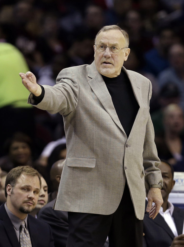 Photo - Minnesota Timberwolves head coach Rick Adelman reacts during the fourth quarter of an NBA basketball game against the Cleveland Cavaliers Monday, Feb. 11, 2013, in Cleveland. The Timberwolves won 100-92. (AP Photo/Tony Dejak)