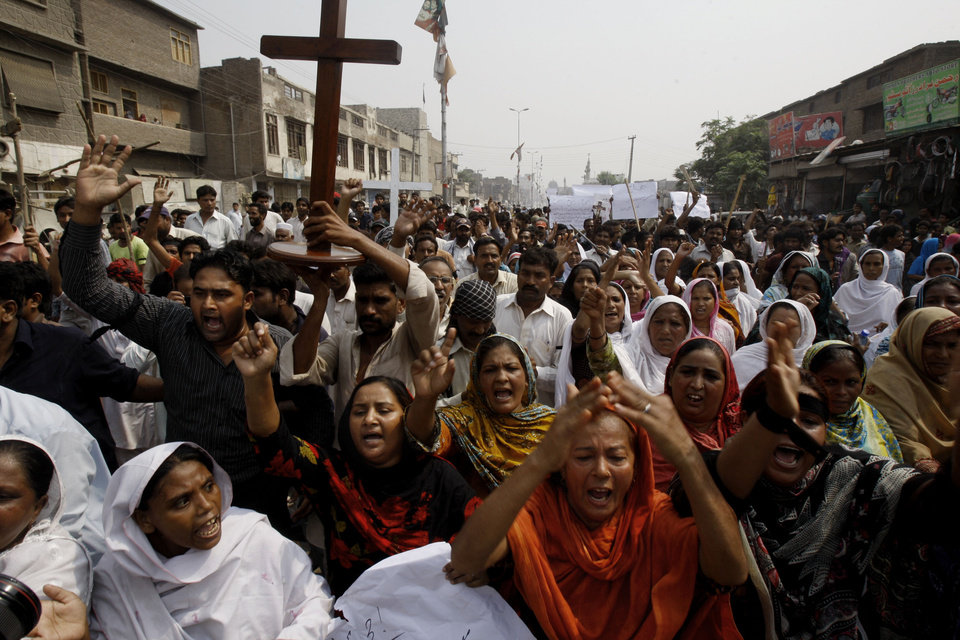 Photo - Pakistani Christians chant slogans during a protest to condemn a suicide bombing on a church in Peshawar,  Pakistan, Monday, Sept. 23, 2013. Angry Pakistani Christians denounced the deadliest attack ever in this country against members of their faith. A pair of suicide bombers blew themselves up amid hundreds of worshippers outside a historic church in northwestern Pakistan. (AP Photo/Mohammad Sajjad)