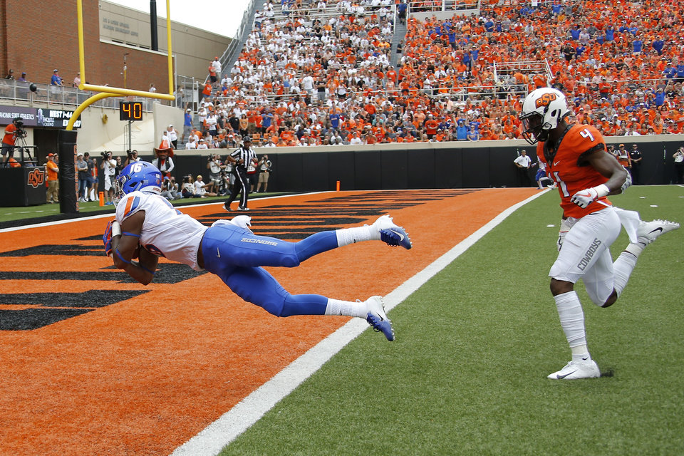 Photo - Boise State's John Hightower (16) leaps to the end zone in front of Oklahoma State's A.J. Green (4) for a touchdown during a college football game between the Oklahoma State University Cowboys (OSU) and the Boise State Broncos at Boone Pickens Stadium in Stillwater, Okla., Saturday, Sept. 15, 2018. Photo by Bryan Terry, The Oklahoman