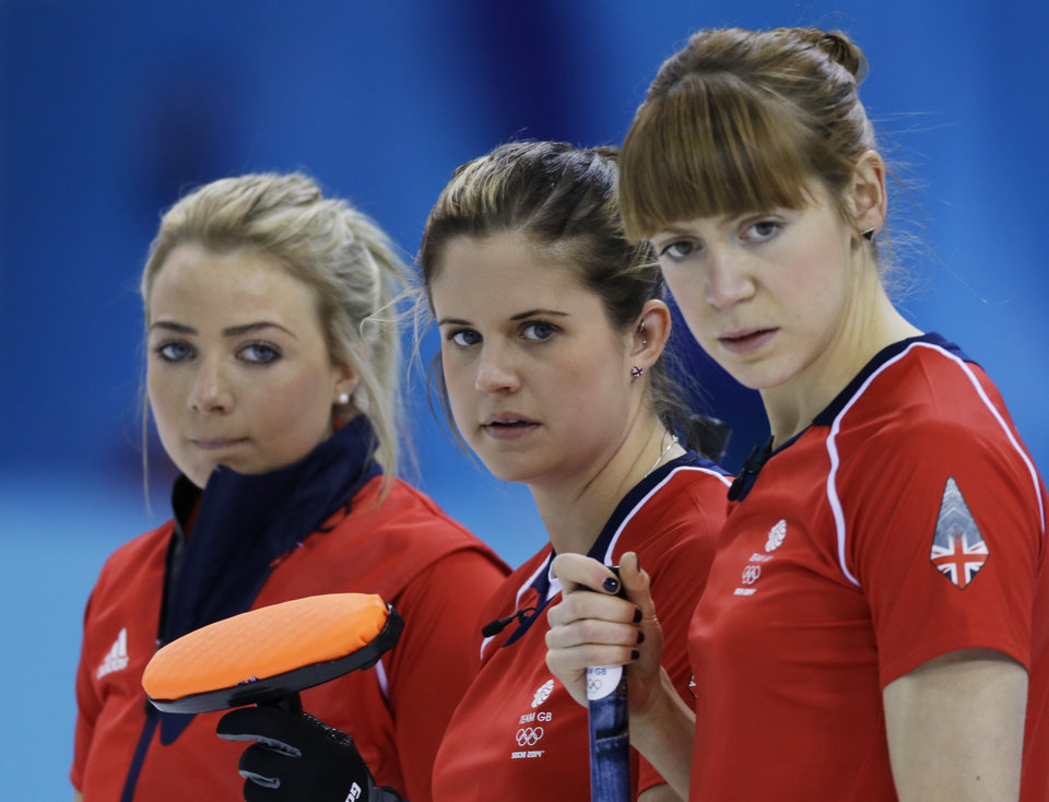 Photo - Great Britain's Anna Sloan, left to right, Vicki Adams and Claire Hamilton watch a shot during their round robin curling match against Japan at the 2014 Winter Olympics, Friday, Feb. 14, 2014, in Sochi, Russia. (AP Photo/Morry Gash)