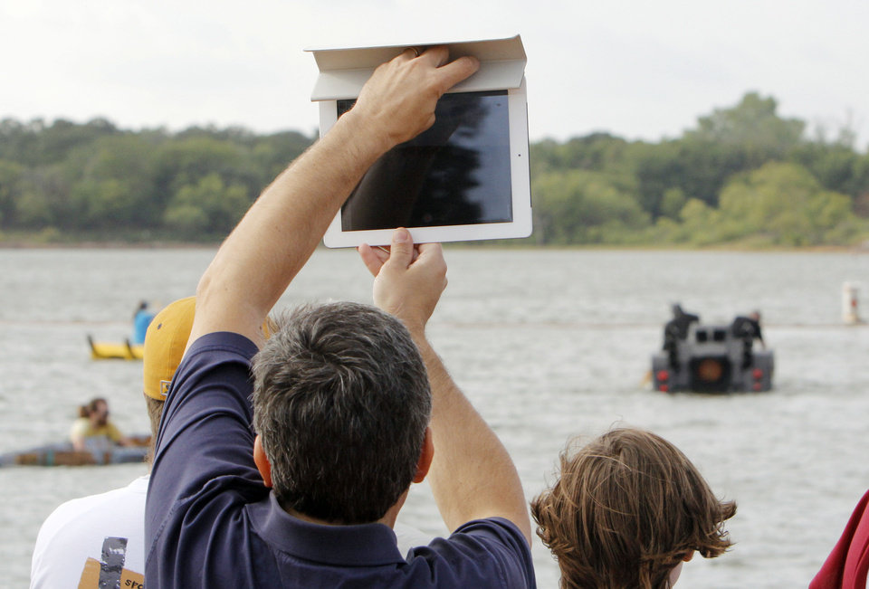 Video is taken on an I-Pad during the Fourth Annual Cardboard Boat Regatta at Arcadia Lake in Edmond, OK, Saturday, August 25, 2012.  By Paul Hellstern, The Oklahoman