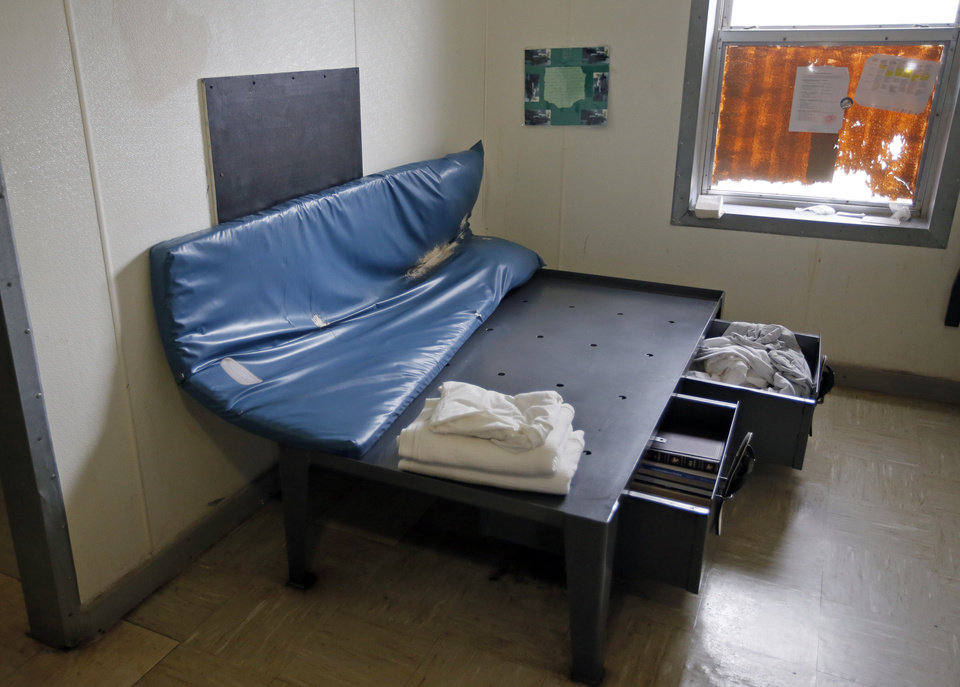 Photo -  A bed is shown in an open-bay dorm at the Central Oklahoma Juvenile Center in Tecumseh. [Photo by Nate Billings, The Oklahoman]