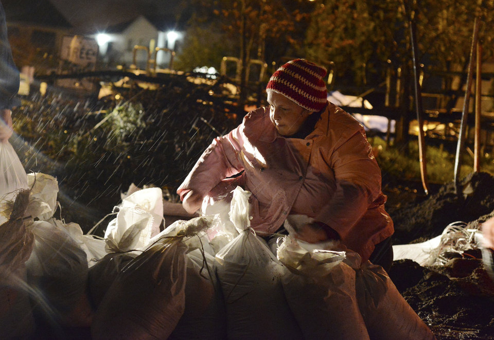 Tara Colvin helps fill sand bags at the Public Works Department in Salem, Ore., on Monday, Nov. 19, 2012. (AP Photo/Statesman-Journal, Danielle Peterson)