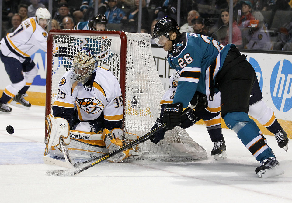 Photo - Nashville Predators goalie Pekka Rinne (35), of Finland, blocks a goal attempt against San Jose Sharks center Michal Handzus (26), of the Czech Republic, during the first period of an NHL hockey game in San Jose, Calif., Saturday, March 2, 2013. (AP Photo/Tony Avelar)