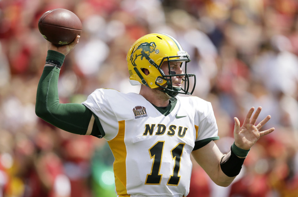 Photo - North Dakota State quarterback Carson Wentz throws a pass during the second half of an NCAA college football game against Iowa State, Saturday, Aug. 30, 2014, in Ames, Iowa. North Dakota State won 34-14. (AP Photo/Charlie Neibergall)