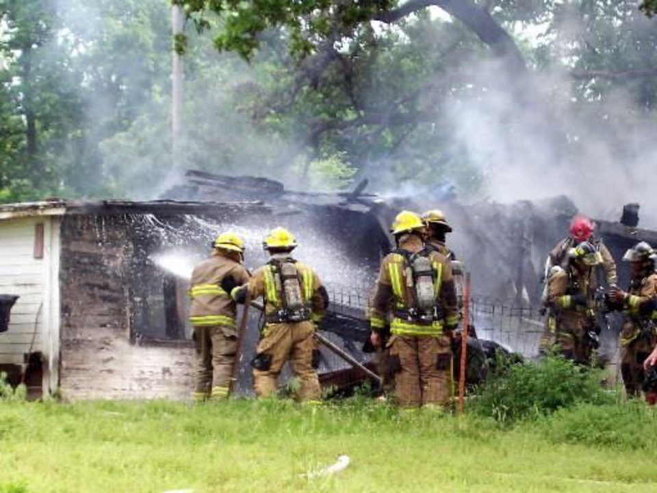 Firefighters spray down hot spots at a house at 1720 E Eubanks Street in  Oklahoma  City that exploded Monday, May 11, 2009. Photo by Johnnie Swanson, for the Oklahoman.