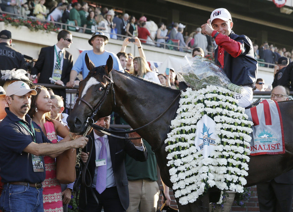 Photo - Joel Rosario poses for photos atop Tonalist after winning the 146th running of the Belmont Stakes horse race, Saturday, June 7, 2014, in Elmont, N.Y. (AP Photo/Seth Wenig)
