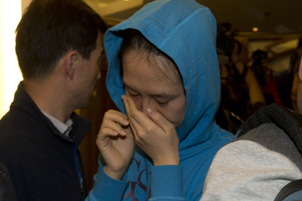 Photo - A relative of a Chinese passenger aboard the Malaysia Airlines MH370, cries after being told the latest update in Beijing, China, Monday, March 24, 2014. A new analysis of satellite data indicates the missing Malaysia Airlines plane crashed into a remote corner of the Indian Ocean, Malaysian Prime Minister Najib Razak said Monday. The news is a major breakthrough in the unprecedented two-week struggle to find out what happened to Flight 370, which disappeared shortly after takeoff from Kuala Lumpur to Beijing with 239 passengers and crew aboard on March 8. (AP Photo/Ng Han Guan)