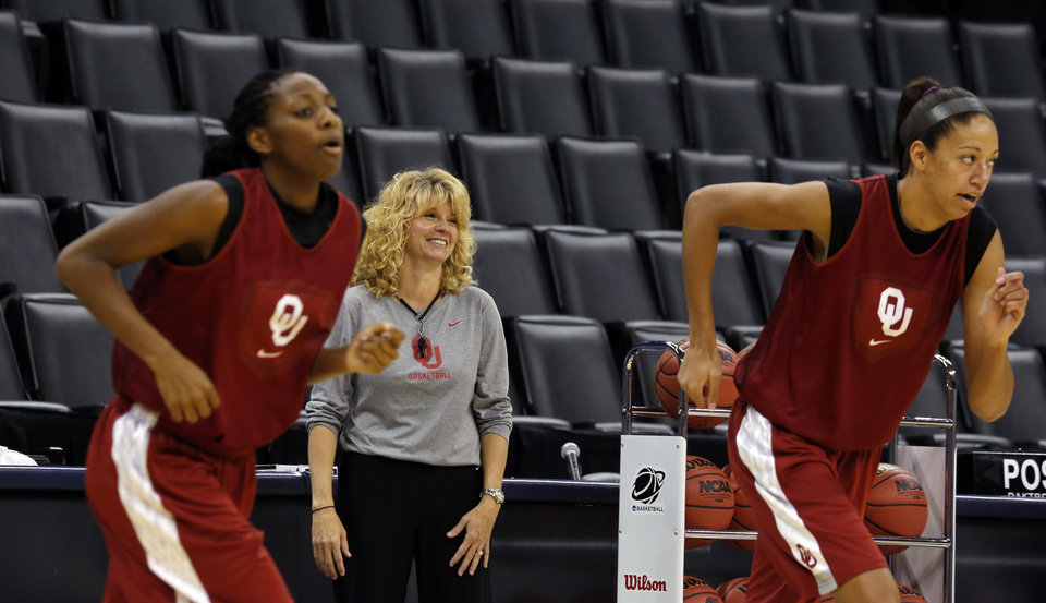 Photo - Oklahoma head coach Sherrie Coale watches practice as Oklahoma guard Sharane Campbell (24) and Oklahoma center Nicole Griffin (4) warm up during the press conference and practice day at the Oklahoma City Regional for the NCAA women's college basketball tournament at Chesapeake Arena in Oklahoma City, Saturday, March 30, 2013. Photo by Sarah Phipps, The Oklahoman