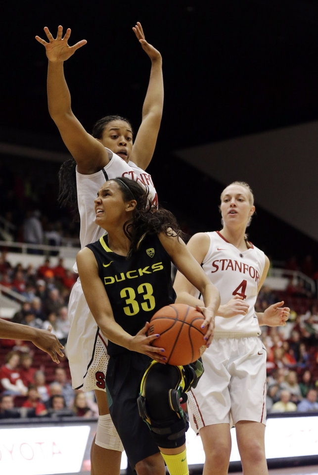 Photo - Oregon guard Lexi Petersen (33) drives to the basket as Stanford forward Erica McCall, top, left, defends during the first half of an NCAA college basketball game on Friday, Jan. 3, 2014, in Stanford, Calif. (AP Photo/Marcio Jose Sanchez)