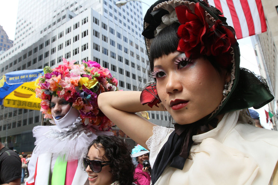 Photo -   Shien Lee, of New York, right, poses for photographers as she and others take part in the Easter Parade along New York's Fifth Avenue Sunday April 24, 2011. (AP Photo/Tina Fineberg)