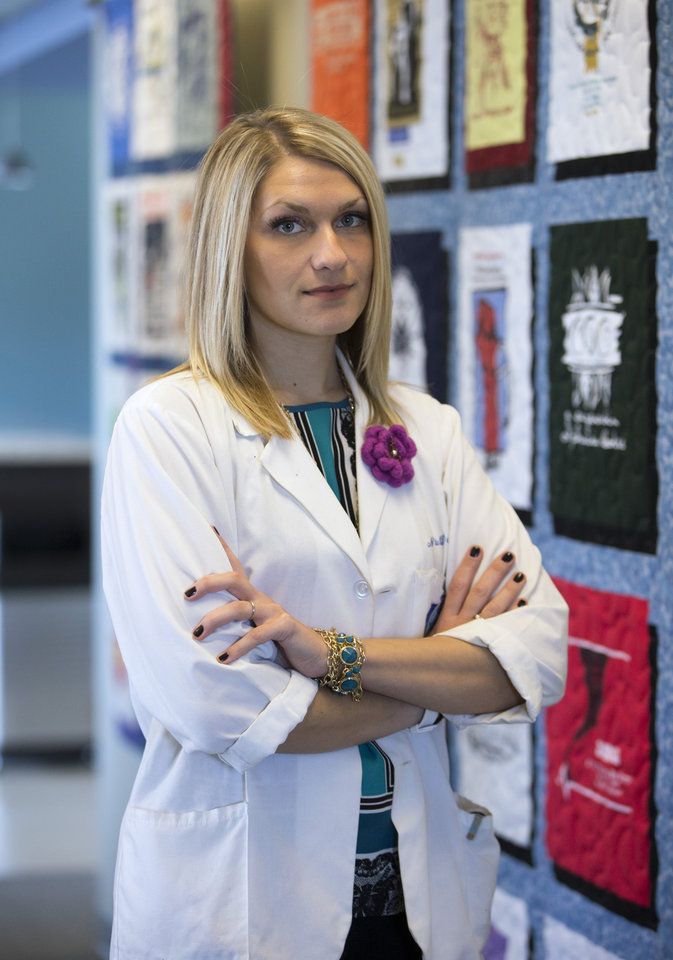Photo -       As costly as medical school was, recent graduate Nida Degesys sees it as an investment in herself and her career, one she thinks will pay off with a higher earning potential. AP Photo   Evan Vucci -  AP