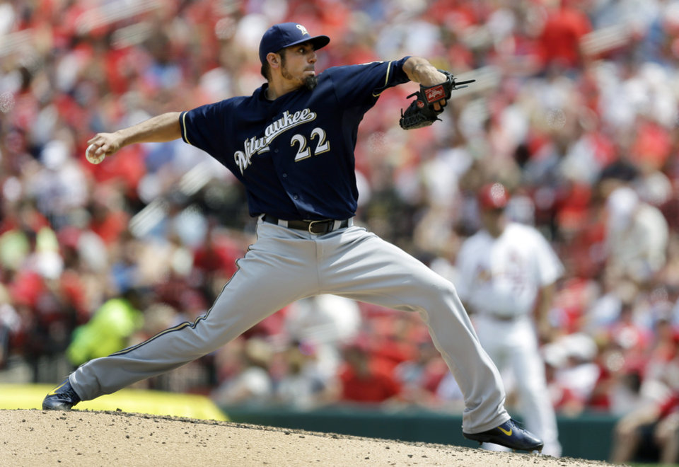 Photo - Milwaukee Brewers starting pitcher Matt Garza throws during the fourth inning of a baseball game against the St. Louis Cardinals, Sunday, Aug. 3, 2014, in St. Louis. (AP Photo/Jeff Roberson)