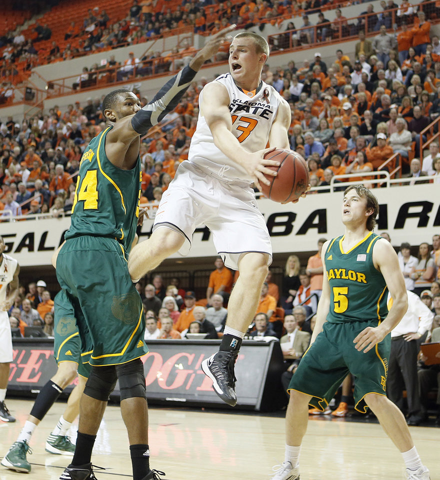 Oklahoma State 's Phil Forte (13) drives past Baylor's Cory Jefferson (34) and Brady Heslip (5) during the college basketball game between the Oklahoma State University Cowboys (OSU) and the Baylor University Bears (BU) at Gallagher-Iba Arena on Wednesday, Feb. 5, 2013, in Stillwater, Okla. Photo by Chris Landsberger, The Oklahoman